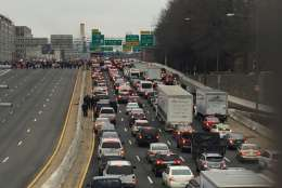 Protesters stop traffic as they march across the freeway. (WTOP/Rob Woodfork)