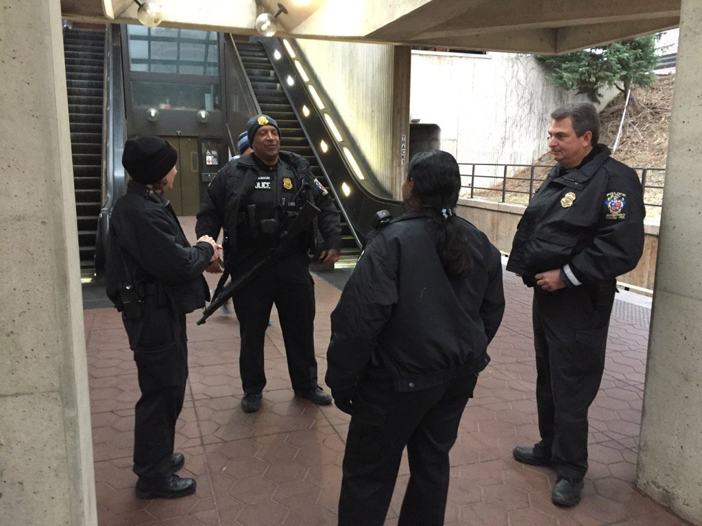 Police presence, complete with long gun, assemble on the platform of White Flint Metro Station. (WTOP/John Aaron)