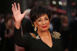 Dame Shirley Bassey poses for photographers upon arrival at the Olivier Awards in London, Sunday, April 3, 2016. (Photo by Joel Ryan/Invision/AP)