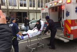 A protester is hospitalized after tear gas is used, and a police officer is treated on scene, WTOP's Mike Murillo reports. (WTOP/Mike Murillo)