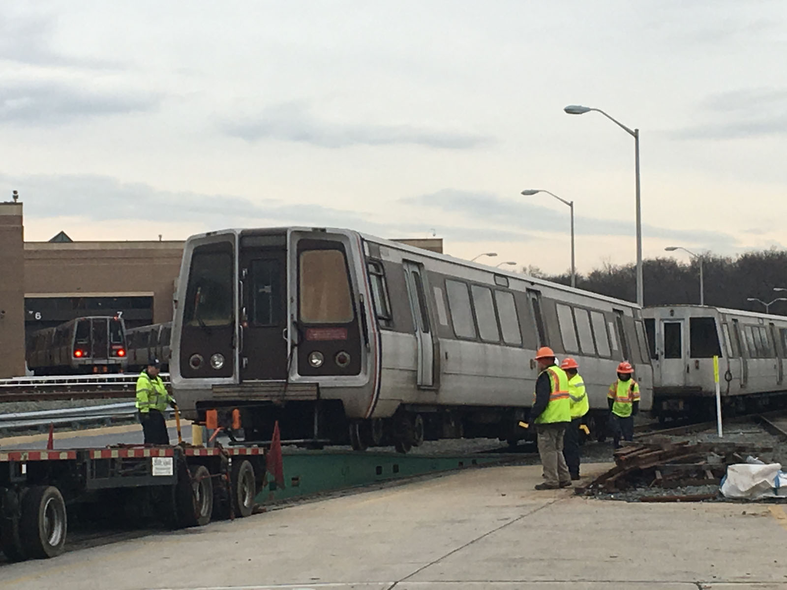 The first retirement of a 4000 Series car came Feb. 15 at Metro's Greenbelt Rail Yards as car 4054 was hauled up onto a flatbed truck and driven to a scrap yard in Baltimore. (WTOP/Max Smith)