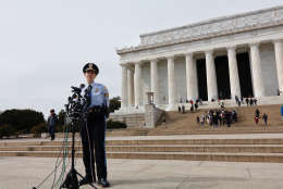 U.S. Park Police spokeswoman Anna Rose speaking to reporters in front of the Lincoln Memorial, one of three monuments where the graffiti appeared. (WTOP/Kate Ryan)