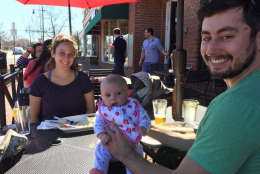 Danielle and Patrick Lamartin, of Alexandria, are happy to get 11-week Gigi out of house. (WTOP/Kristi King)