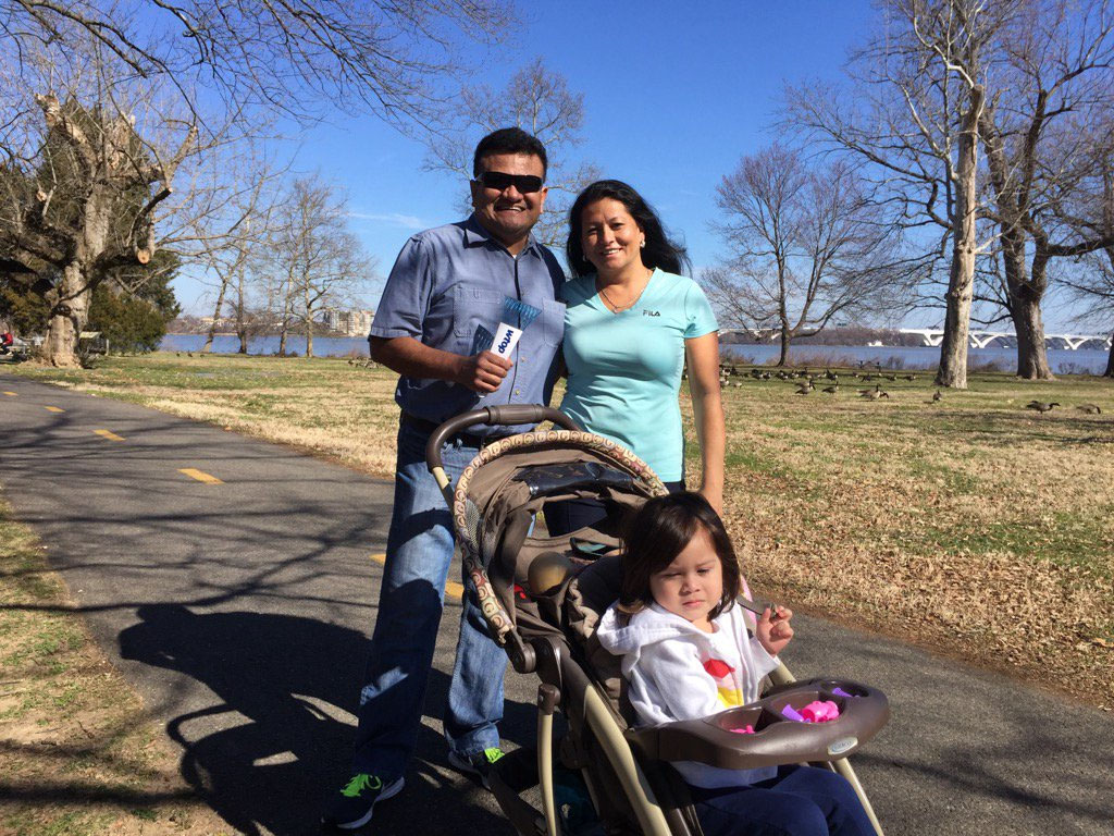 Grandparents Julio and Yolanda Gonzalez, of Beacon Hill, enjoy a stroll with 2-year-old Isabella. (WTOP/Kristi King)
