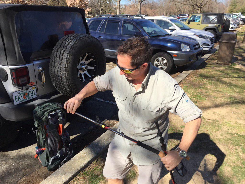 Extending his walking poles, hiker Steve Melians, of Mt. Vernon, is training for a four-month hike. (WTOP/Kristi King)