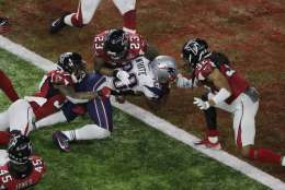 New England Patriots' James White scores the winning touchdown during overtime of the NFL Super Bowl 51 football game against the Atlanta Falcons, Sunday, Feb. 5, 2017, in Houston. (AP Photo/Charlie Riedel)