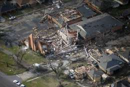 A destroyed church and homes are seen in this aerial photo after a tornado tore through the eastern neighborhood in New Orleans, Tuesday, Feb. 7, 2017. (AP Photo/Gerald Herbert)
