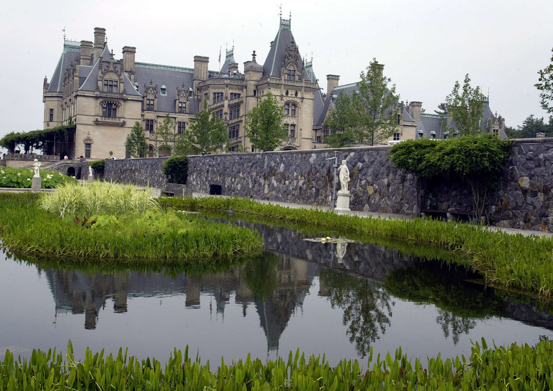 **ADVANCE FOR WEEKEND JULY 16-17**The Biltmore House is reflected in a pond on the estate in Asheville, N.C., Wednesday July 6, 2005. Seventy-five years after it was first opened to the public, George W. Vanderbilt's grand Biltmore House is showing off a new side. Ten rooms on the house's fourth floor _ including several that housed the servants who kept the 250-room house running _ have been restored and opened to the public for the first time. (AP Photo/Chuck Burton)