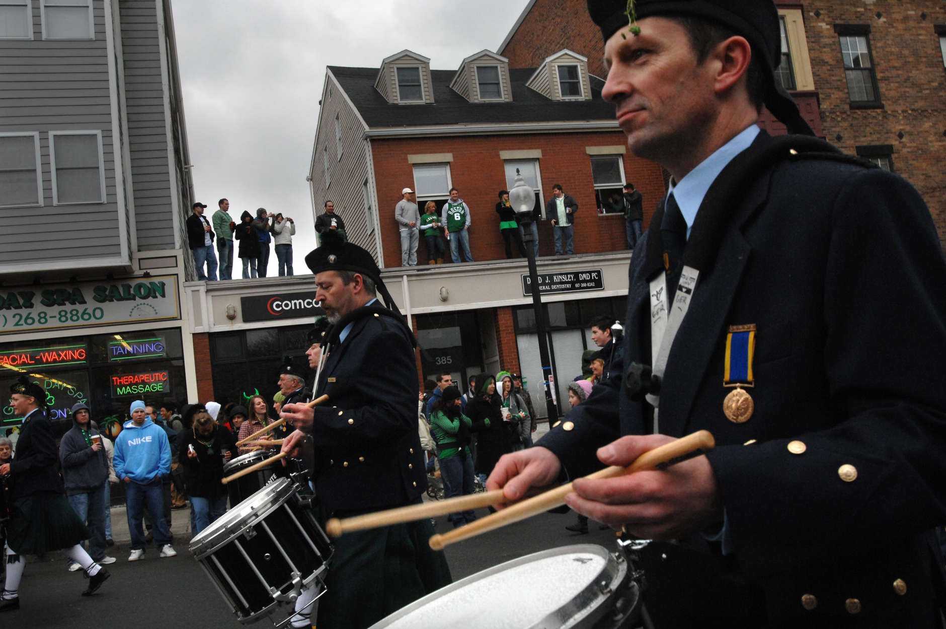 John D. O'Connor of Dublin, Ireland plays drums as he marches with the Irish Prison Service Pipe Band, of  Dublin, Ireland, during, the St. Patrick's Day Parade in South Boston, Sunday, March 16, 2008. (AP Photo/Josh Reynolds)