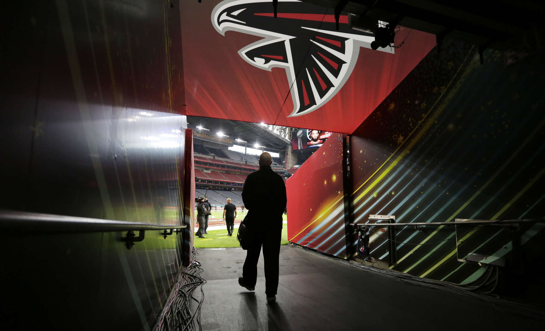 Atlanta Falcons head coach Dan Quinn walks down the team's tunnel to the field during a walk through at NRG Stadium on the eve of NFL Super Bowl 51 football game Saturday, Feb. 4, 2017, in Houston. Atlanta will face the New England Patriots in the Super Bowl Sunday. (AP Photo/Eric Gay)