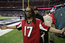 Rapper Lil Jon poses before the NFL Super Bowl 51 football game between the New England Patriots and the Atlanta Falcons, Sunday, Feb. 5, 2017, in Houston. (AP Photo/Chuck Burton)