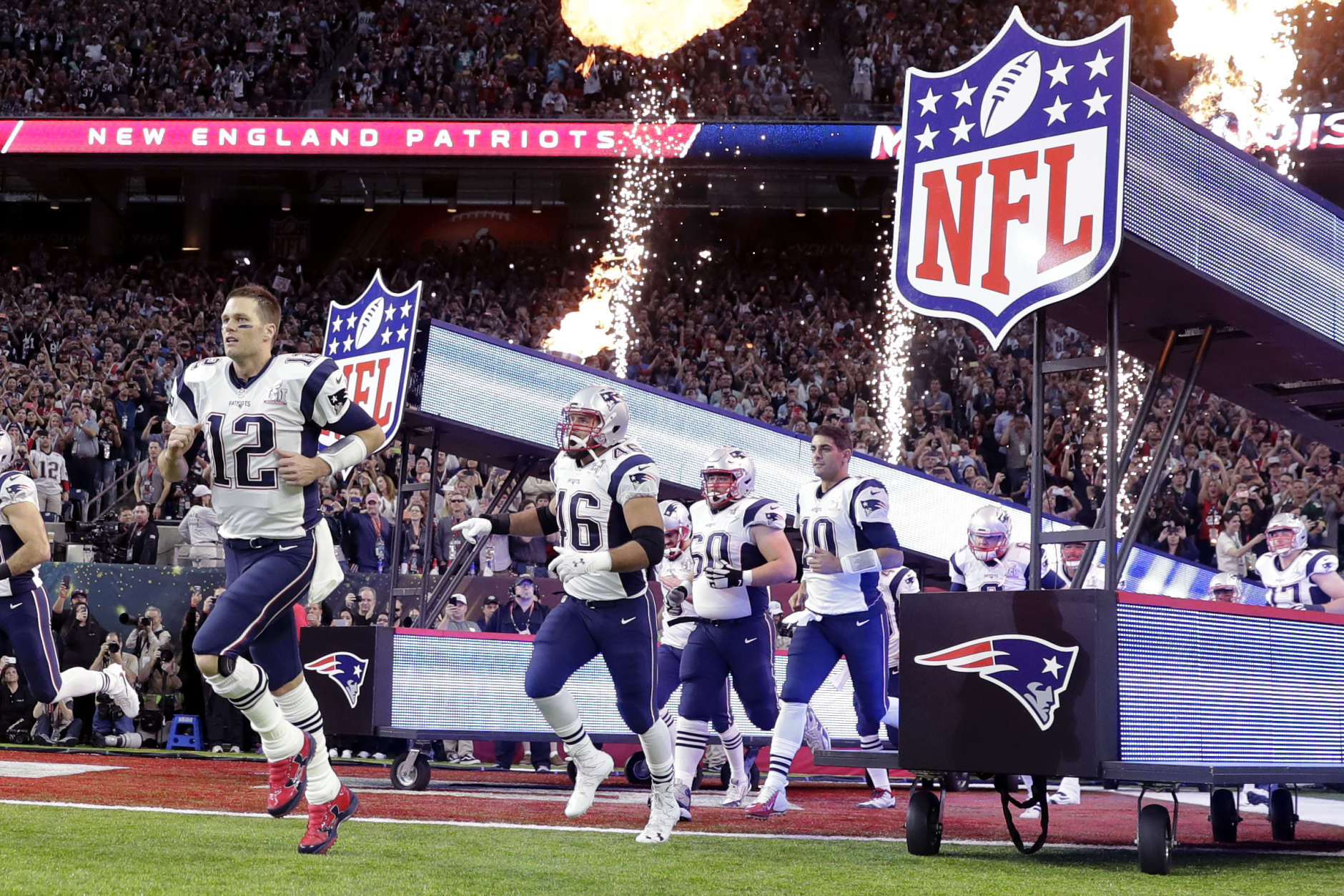 New England Patriots' Tom Brady runs on the field with teammates before the NFL Super Bowl 51 football game against the Atlanta Falcons Sunday, Feb. 5, 2017, in Houston. (AP Photo/Darron Cummings)