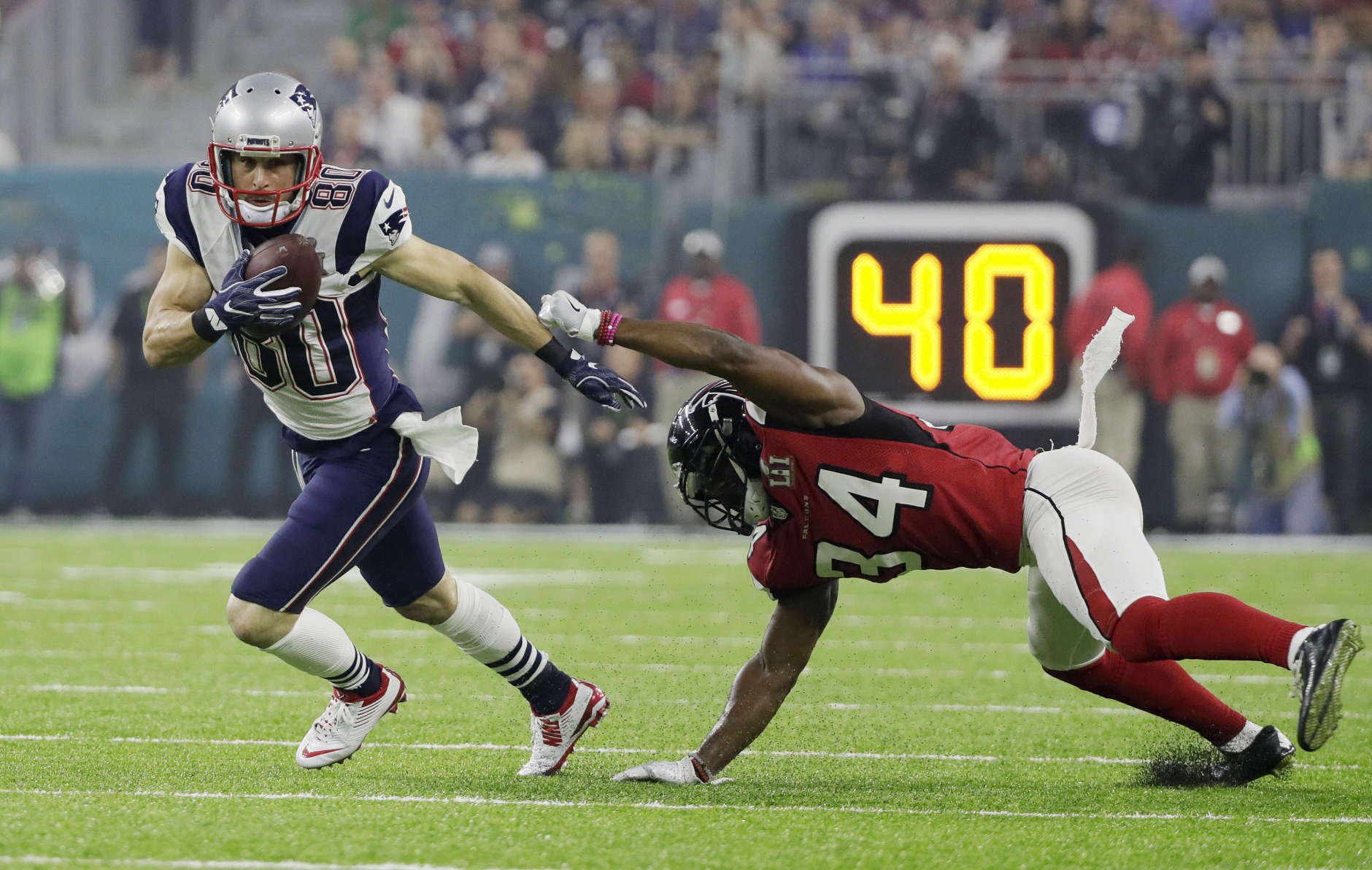 New England Patriots' Danny Amendola runs against Atlanta Falcons' Brian Poole during the second half of the NFL Super Bowl 51 football game Sunday, Feb. 5, 2017, in Houston. (AP Photo/Mark Humphrey)