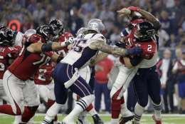 Atlanta Falcons' Matt Ryan (2) fumbles as he is hit by New England Patriots' Dont'a Hightower, obscured at rear, during the second half of the NFL Super Bowl 51 football game Sunday, Feb. 5, 2017, in Houston. (AP Photo/Eric Gay)