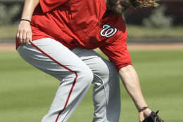 Washington Nationals left fielder Jayson Werth fields a ball during a spring training baseball workout Sunday, Feb. 19, 2017, in West Palm Beach, Fla. (AP Photo/David J. Phillip)