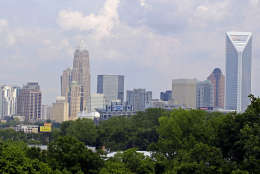 In this July 17, 2012 photo the skyline of Charlotte, N.C., is shown. Much was made about Charlotte emerging on the big stage when Democrats awarded their 2012 national convention to the city last year. But the tidy city of gleaming skyscrapers built with money during the flush years of banking is more in its middle age, trying to reinvent itself without cutting all the ties to its big cash past. (AP Photo/Chuck Burton)