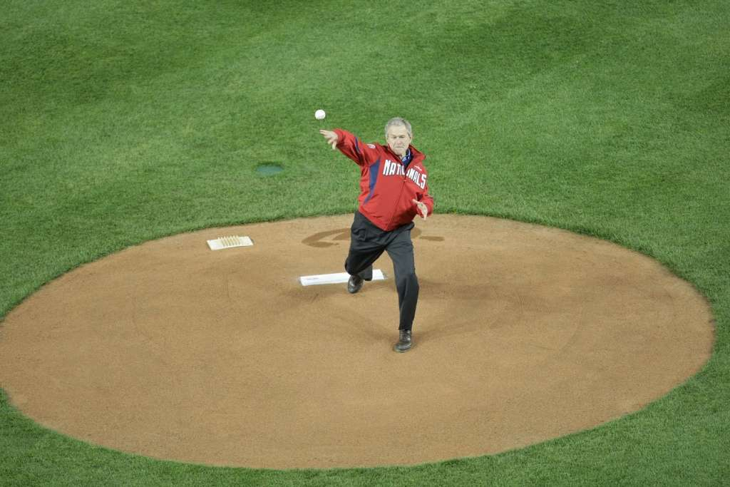 Former President George W. Bush throws the first pitch on opening day in 2008 at Nationals Park.  (Getty Images/Drew Hallowell)