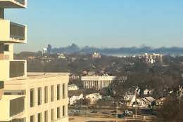 A thick plume of smoke was visible across the sky early Saturday. (Courtesy @surrrewhynot via Twitter)