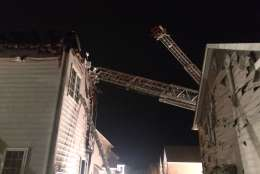 The houses on either side face heat damage. (Courtesy Pete Piringer/Montgomery County Fire & Rescue)