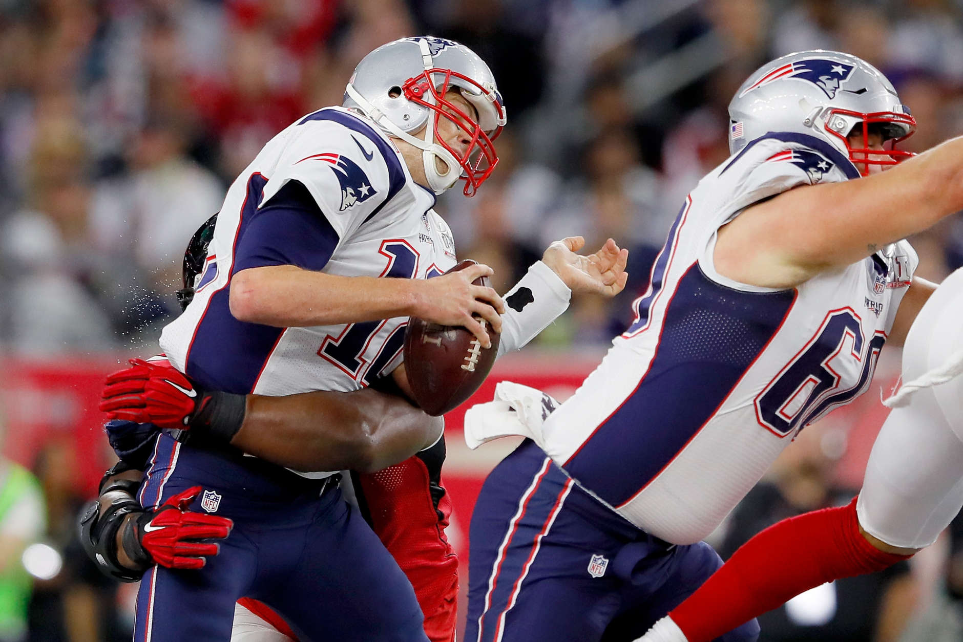 HOUSTON, TX - FEBRUARY 05: Tom Brady #12 of the New England Patriots is hit in the first quarter against the Atlanta Falcons during Super Bowl 51 at NRG Stadium on February 5, 2017 in Houston, Texas.  (Photo by Kevin C. Cox/Getty Images)