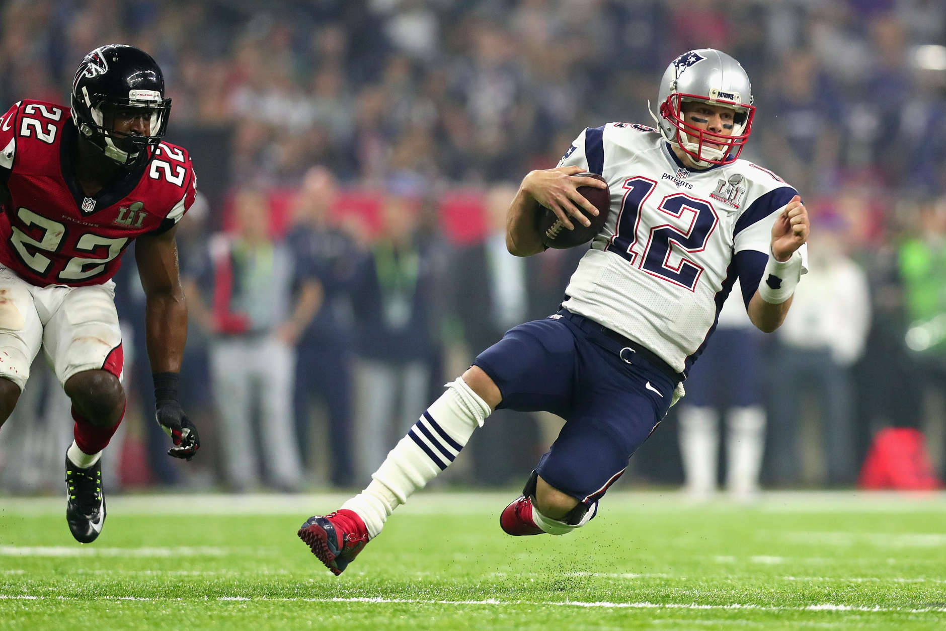 HOUSTON, TX - FEBRUARY 05:  Tom Brady #12 of the New England Patriots runs for a first down against the Atlanta Falcons in the third quarter during Super Bowl 51 at NRG Stadium on February 5, 2017 in Houston, Texas.  (Photo by Tom Pennington/Getty Images)