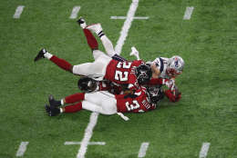 HOUSTON, TX - FEBRUARY 05:  Julian Edelman #11 of the New England Patriots makes a 23 yard catch in the fourth quarter against Ricardo Allen #37, Robert Alford #23 and Keanu Neal #22 of the Atlanta Falcons during Super Bowl 51 at NRG Stadium on February 5, 2017 in Houston, Texas.  (Photo by Ezra Shaw/Getty Images)
