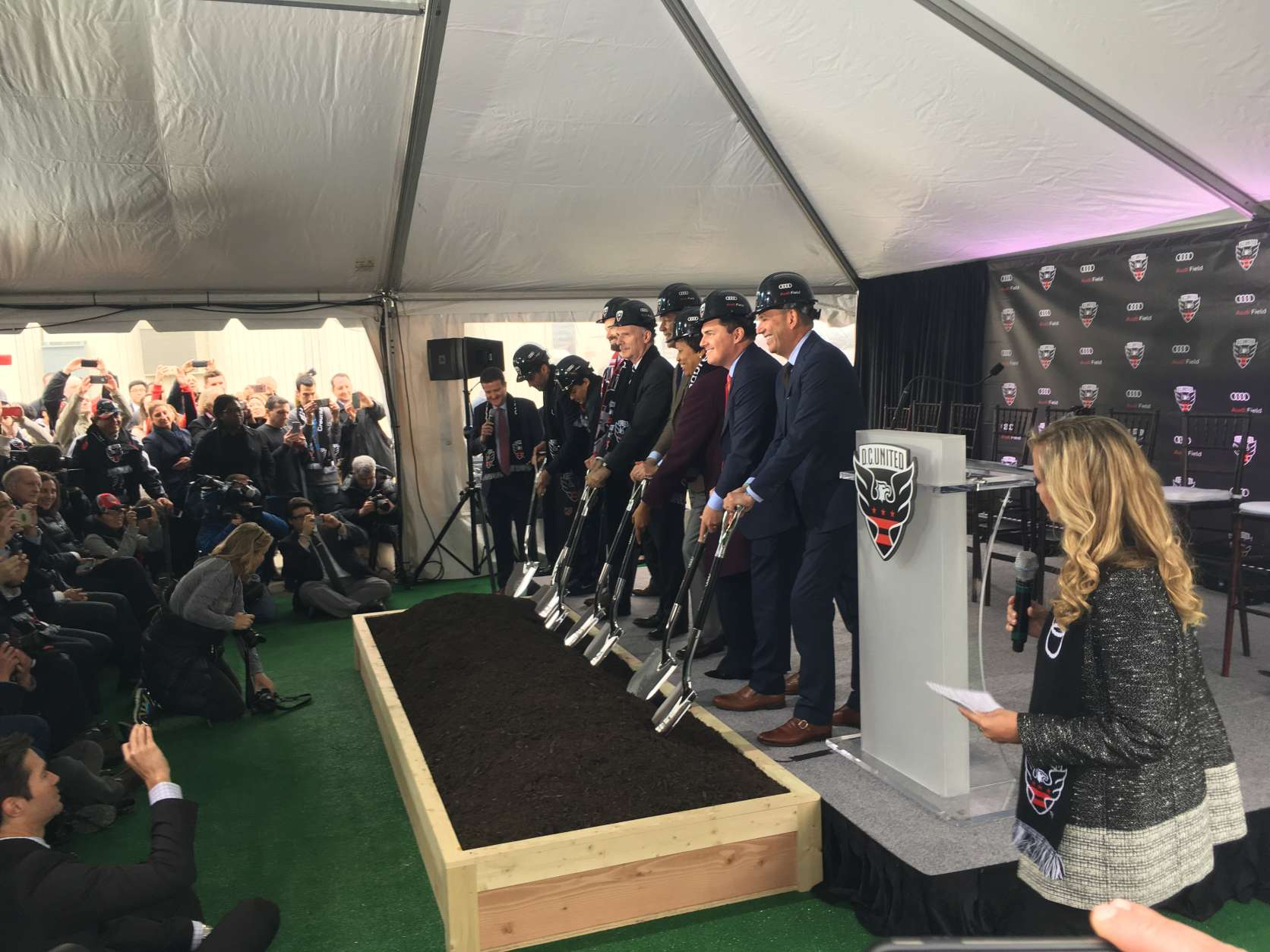 Representatives from D.C. government, D.C. United and Audi break ground on the team's future home. (WTOP/Noah Frank)