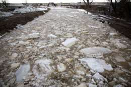 In this Thursday, Feb. 9, 2017 photo, large chunks of ice float down the low line canal in Buhl, Idaho. Warm weather is melting historic snowfall, particularly in the Magic Valley, where a canal was partially breached overnight Thursday, flooding an area near Castleford and Buhl. (Pat Sutphin/The Times-News via AP)/The Times-News via AP)