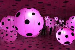 Another room contains a giant polka dotted orb which visitors can walk into where they'll find another mirrored room. (WTOP/Megan Cloherty)