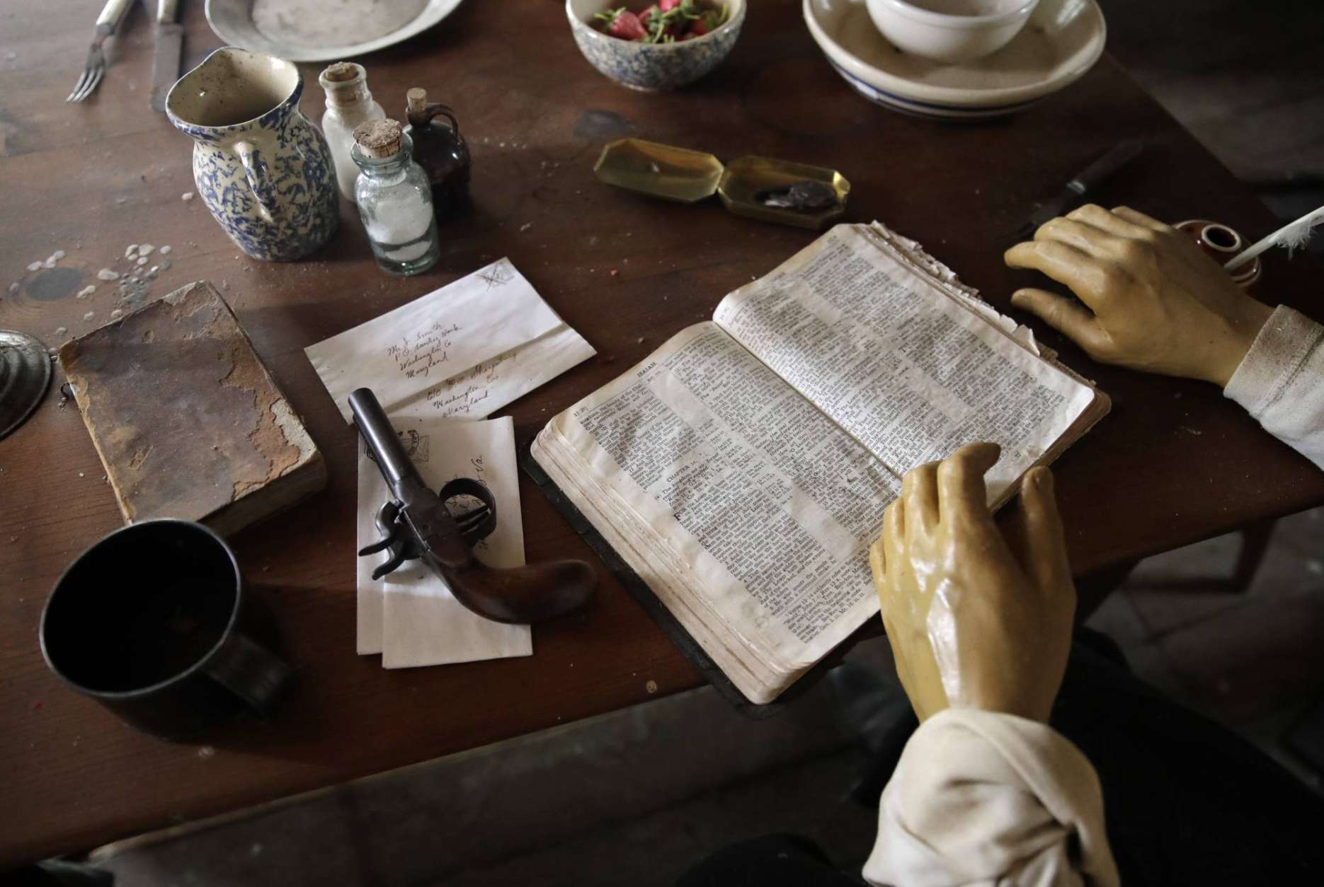 In this Feb. 8, 2017 photo, a gun, a bible and other items sit in front of a mannequin depicting abolitionist John Brown, right, in the restored farmhouse where Brown launched his ill-fated, 1859 seizure of a federal armory in Dargan, Md. Historians cite the failed raid by Brown and 18 fervent followers in nearby Harpers Ferry, W.Va., as the opening salvo in the Civil War because it incited strong passions, especially in the slave-holding South. The farmhouse was designated a national historic landmark in 1973. (AP Photo/Patrick Semansky)