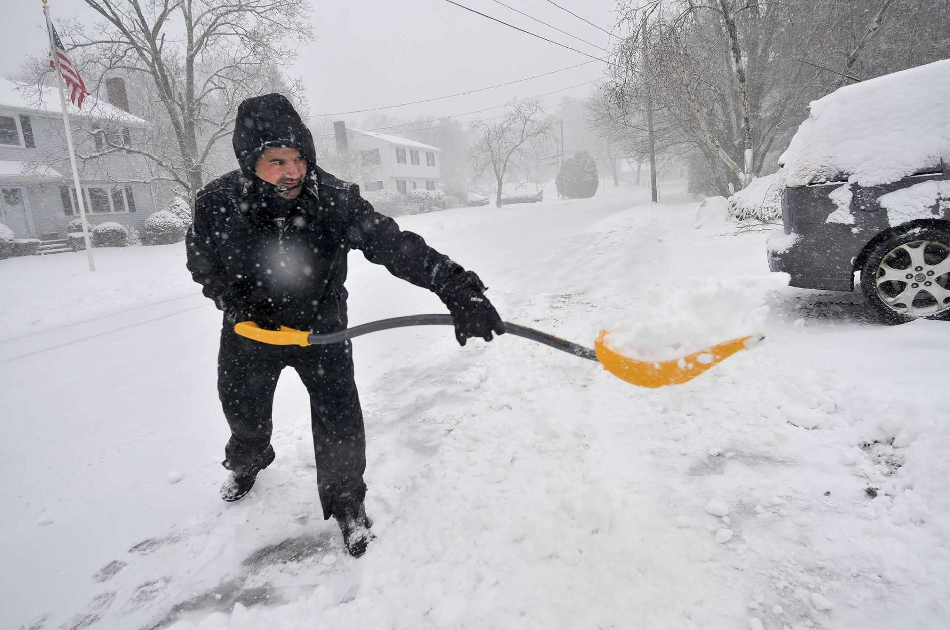 Rob Yozzo gets an early start shoveling snow from his driveway at his Birch Tree Road home in Foxborough, Mass., during a snowstorm, Thursday, Feb. 9, 2017. (Mark Stockwell/The Sun Chronicle via AP)