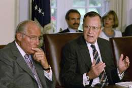 FILE - In this June 9, 1992 file photo, then-House Minority leader Bob Michel of Ill. listens at left as President George H.W. Bush in the Cabinet Room of the White House in Washington. A former aide says Michel has died at age 93. (AP Photo/Dennis Cook, File)