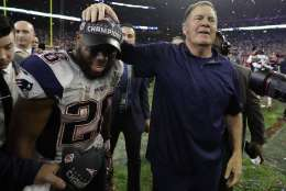 New England Patriots head coach Bill Belichick celebrates with James White after the NFL Super Bowl 51 football game against the Atlanta Falcons Sunday, Feb. 5, 2017, in Houston. The Patriots won 34-28 in overtime. (AP Photo/Eric Gay)