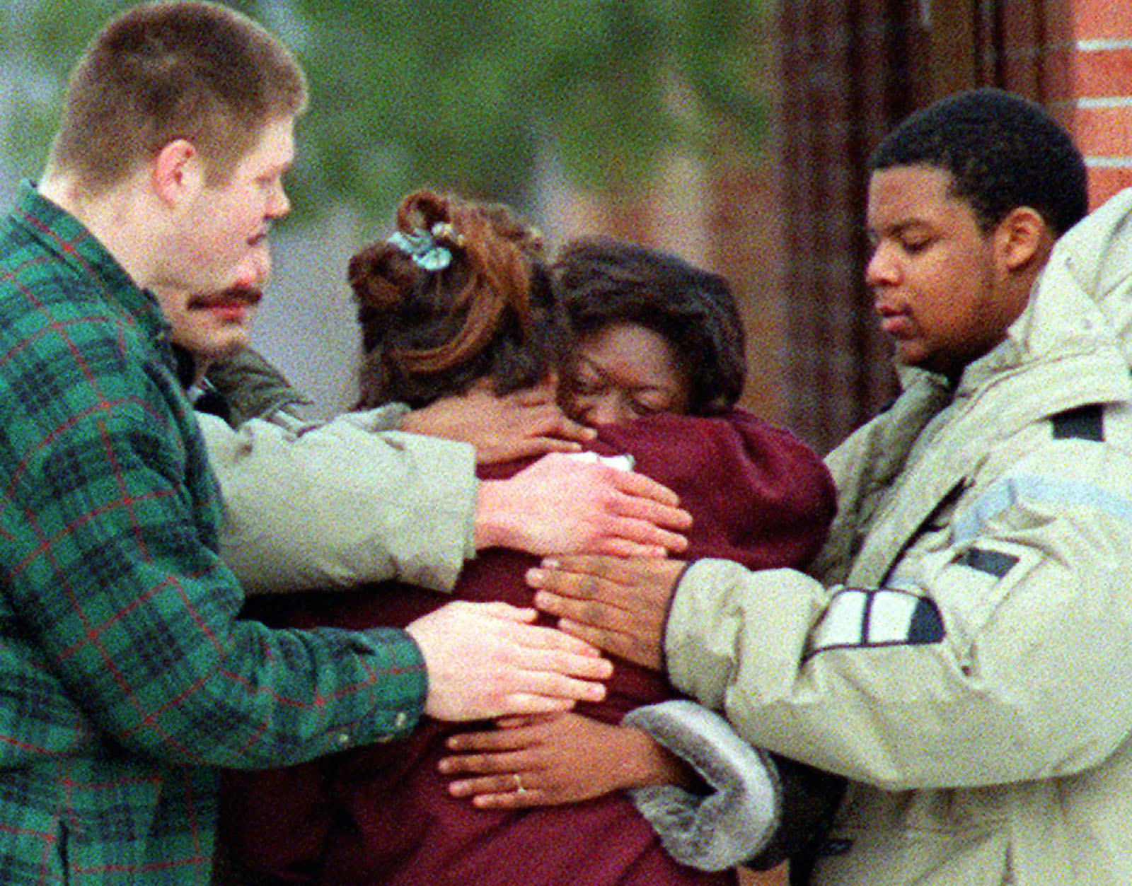 Some of the members of the Job Corps center near Harpers Ferry, W. Va. console one another Saturday, Feb. 17, 1996. All 17 passengers aboard a MARC commuter train were Job Corps members traveling for a long weekend when it collided with an Amtrak passenger train in Silver Spring, Md. Friday evening, Feb. 16, 1996. (AP Photo/J. Scott Applewhite)