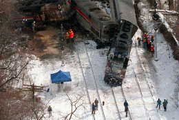 The MARC train, right,  and an Amtrak train that collided Friday, Feb. 16, 1996  in Silver Spring, Md., are seen in this aerial view Saturday, Feb. 17, 1996.  (AP Photo/Doug Mill)