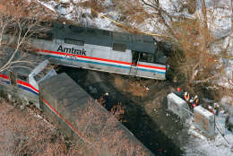 The Amtrak locomotive that hit a MARC commuter train Friday night, killing at least 11 people, is seen in this aerial view Saturday, Feb. 17, 1996 in Silver Spring, Md. At right, workers inspect signal switching equipment. (AP Photo/Doug Mills)