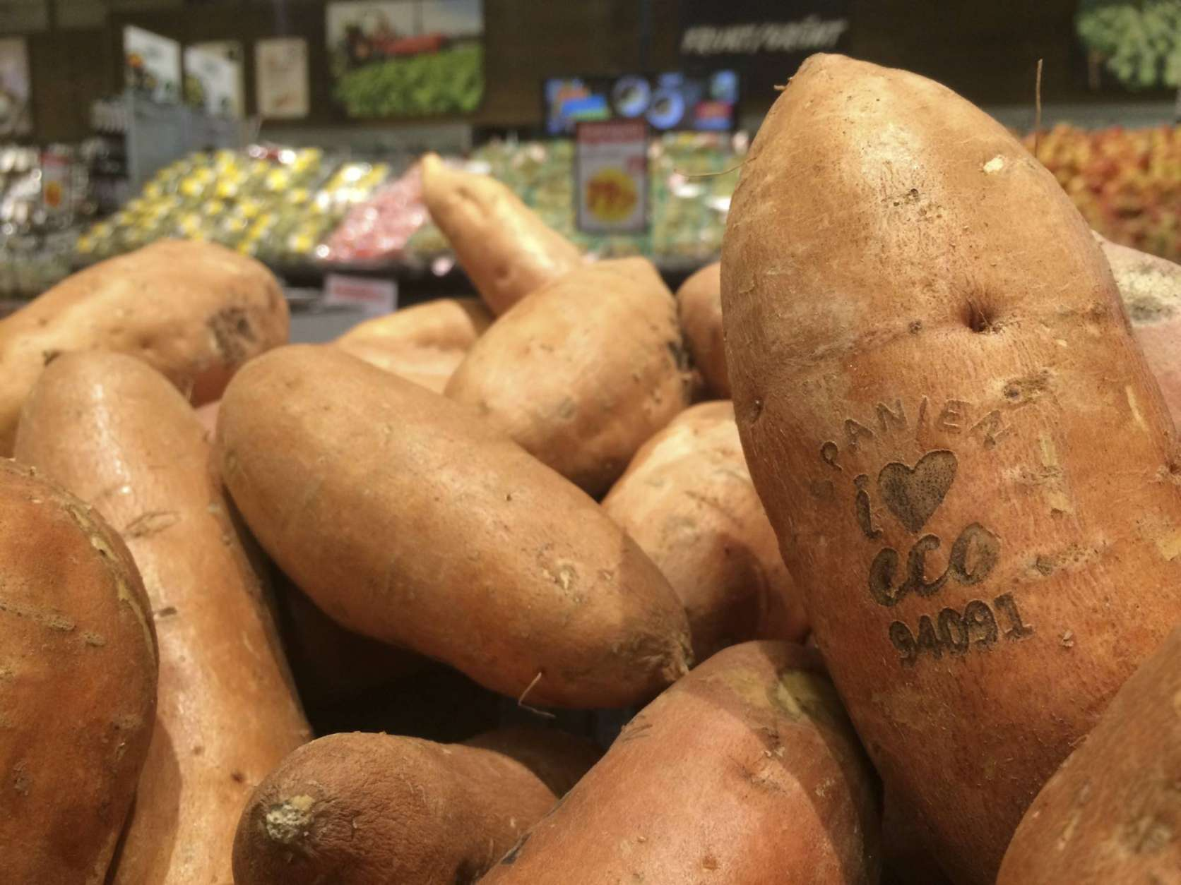 In this photo taken on Tuesday Jan. 31, 2017, laser branded sweet potatoes are displayed at the ICA Kvantum supermarket in Malmo, Sweden. Something high-tech is happening in the produce aisle at some Swedish supermarkets, where laser marks have replaced labels on the organic avocados and sweet potatoes. (AP Photo/James Brooks)