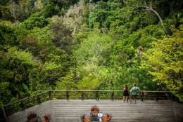 This undated photo shows visitors taking in a lookout area at the Lapa Rios Lodge in Costa Rica. Owner Hans Pfister says business at the lodge was hurt last year by concerns over the Zika virus, which is spread by mosquitoes, but this year Zika has faded from the headlines and Pfister says his guests are back. (Lapa Rios Lodge via AP)