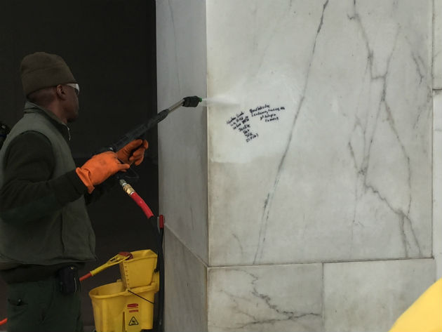 A worker sprays graffiti at the Lincoln Memorial on Tuesday. (Photo courtesy National Park Service)