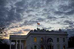 FILE - In this Jan. 13, 2017, file photo, the sun rises behind the White House in Washington. In his third week in office, President Donald Trump's young government remains a work in progress, with hundreds of empty desks in agency offices across Washington. While the president has criticized Democrats for the delays, he also shares at least part of the blame for moving more slowly than his predecessor to submit vetting information and paperwork for his nominations. Attorney General Jeff Sessions was Trump's eighth member of his administration to be confirmed; at this point eight years ago Obama had 23 officials confirmed, including department heads and deputies. (AP Photo/Pablo Martinez Monsivais)