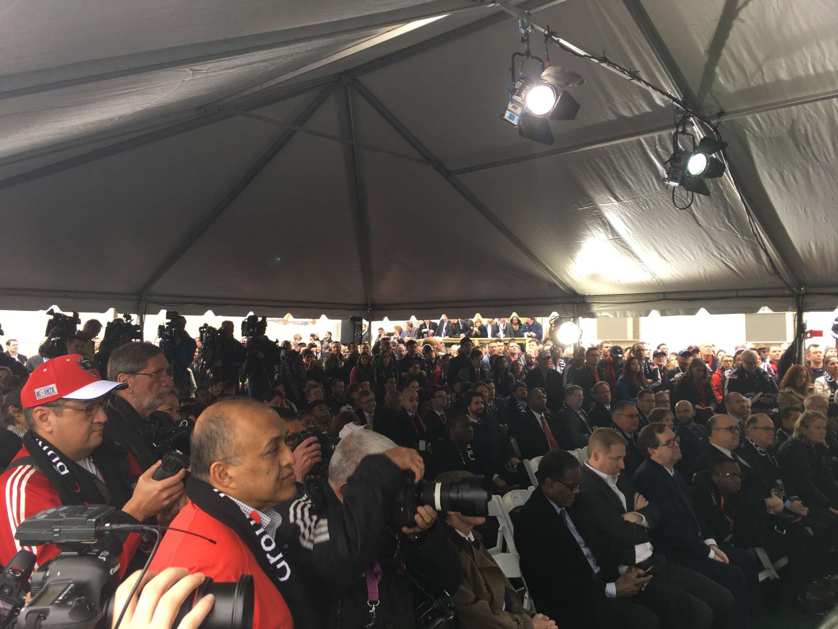 A crowd of sponsors, fans, partners and media gathers for the groundbreaking ceremony. (WTOP/Noah Frank)