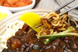Korean / Chinese pork and vegetable noodles in black bean sauce served with danmuji and kimchi.