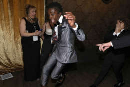 """Caleb McLaughlin, left, and Gaten Matarazzo appear backstage after accepting the award for outstanding performance by an ensemble in a drama series for """"Stranger Things"""" at the 23rd annual Screen Actors Guild Awards at the Shrine Auditorium & Expo Hall on Sunday, Jan. 29, 2017, in Los Angeles. (Photo by Matt Sayles/Invision/AP)"""