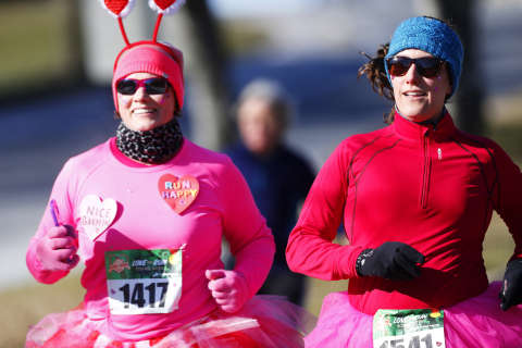 Runners wear hearts on their bibs at Valentine's Day 5K