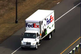 Giant panda Bao Bao travels by a FedEx truck to Dulles International Airport, where she will board a cargo plane bound for China on Tuesday, Feb. 21, 2017. (Courtesy NBC Washington)