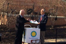 Chinese Ambassador Cui Tiankai accepts postcards and wellwishes for Bao Bao at the National Zoo on Tuesday, Feb. 21, 2017. The giant panda, born at the zoo in 2013, is heading to China where she wil eventually join a breeding program. (WTOP/Nick Iannelli)