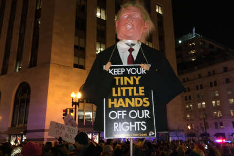 Protesters dance from Trump Hotel to White House