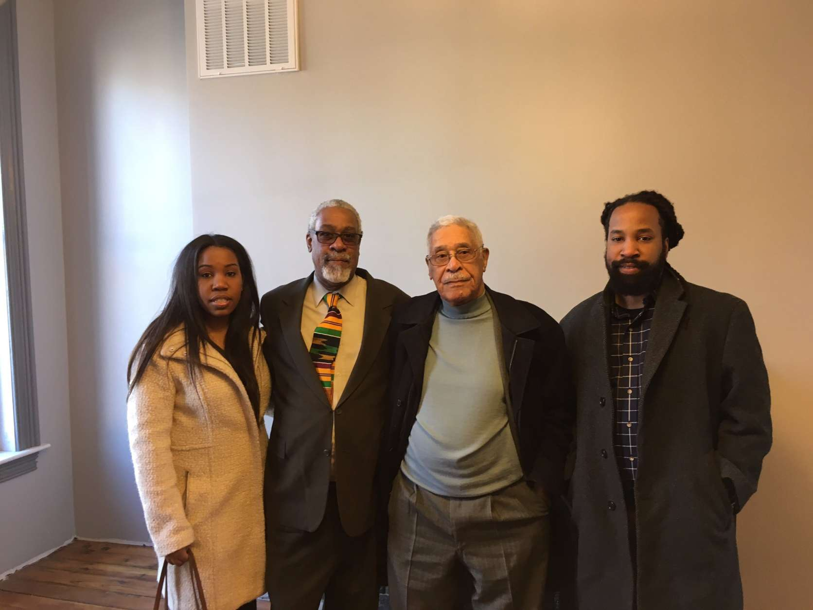 Robert Vest (3rd from left) worked for Dr. Woodson. He's in his 90s now. Pictured with son and grandchildren. (WTOP/Liz Anderson)