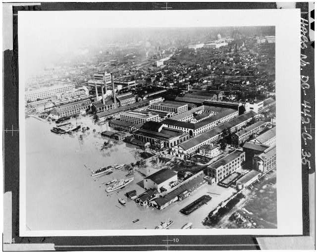 hotographic copy of an historic photograph (From the Navy Yard Historical Center). AERIAL VIEW OF THE NAVY YARD DURING THE 1936 FLOOD. VIEW LOOKING NORTHWEST. BUILDING 36, JUST RIGHT OF CENTER, CONSISTS OF THE EAST AND NORTH WINGS OF THE QUADRANGLE STRUCTURE. - Navy Yard, Ordnance Building, Intersection of Paulding & Kennon Streets, Washington, District of Columbia, DC