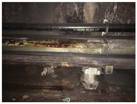 Water leaks also contribute to electrical arcing incidents, and the FTA has urged Metro to address the issue. This photo illustrates leaking on the electrified third rail. (Photo courtesy Federal Transit Agency)